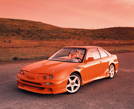 AUT 25 RK1197 03 © Kimball Stock 1992 Acura Integra GS Orange Front 3/4 View On Pavement By Hills Filtered