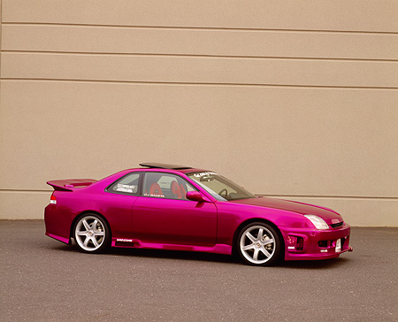 AUT 25 RK1205 02 © Kimball Stock 1997 Honda Prelude SH Candy Violet 3/4 Side View On Pavement By Wall