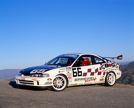 AUT 25 RK1215 02 © Kimball Stock 1997 Acura Integra Type R Race Car #66 White 3/4 Front View On Pavement Blue Sky