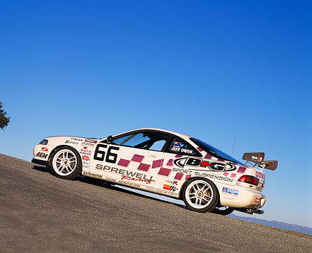 AUT 25 RK1216 01 © Kimball Stock 1997 Acura Integra Type R Race Car #66 White 3/4 Rear View Slanted Rear View On Pavement