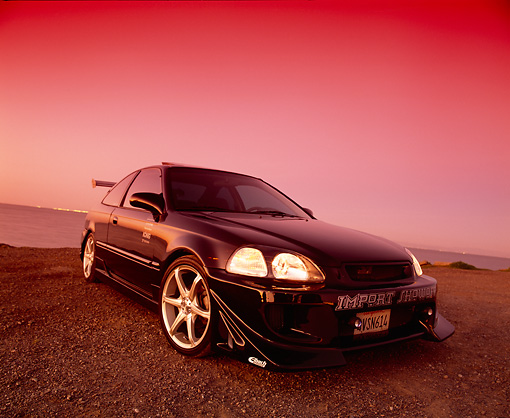 AUT 25 RK1287 01 © Kimball Stock 1997 Honda Civic Custom Black Wide Angle Low 3/4 View On Gravel By Water Filtered