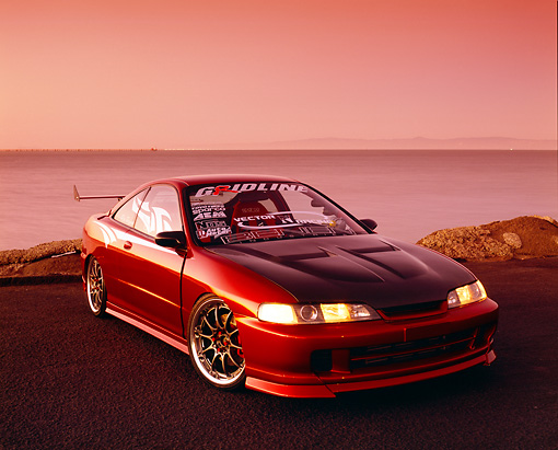 AUT 25 RK1297 01 © Kimball Stock 1997 Acura Integra Red 3/4 Front View On Pavement By Water Filtered