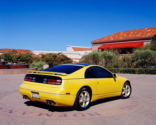 AUT 25 RK1352 01 © Kimball Stock 1990 Nissan 300ZX Yellow Rear 3/4 View On Pavement