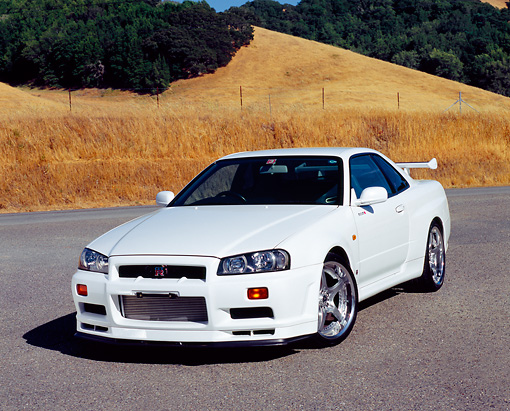 AUT 25 RK1359 04 © Kimball Stock 1999 Nissan Skyline GTR R34 White 3/4 Front View On Pavement By Dry Grass Hills