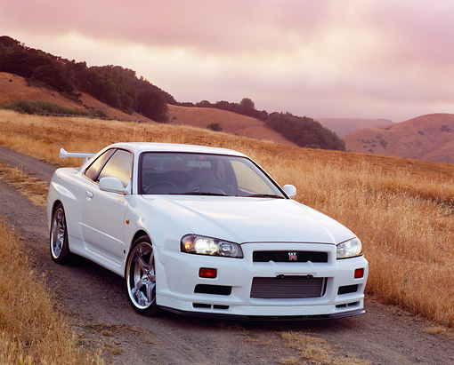 AUT 25 RK1362 02 © Kimball Stock 1999 Nissan Skyline GTR R34 White 3/4 Front View On Dry Grass Hill
