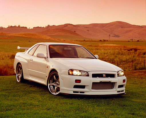 AUT 25 RK1368 01 © Kimball Stock 1999 Nissan Skyline GTR R34 White 3/4 Front View On Grass Filtered