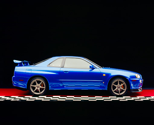 AUT 25 RK1392 07 © Kimball Stock 1999 Nissan Skyline GTR Blue Profile View On Checkered Line Red Floor Studio