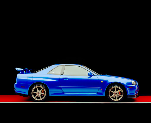 AUT 25 RK1393 10 © Kimball Stock 1999 Nissan Skyline GTR Blue Profile View On Red Floor Gray Line Studio