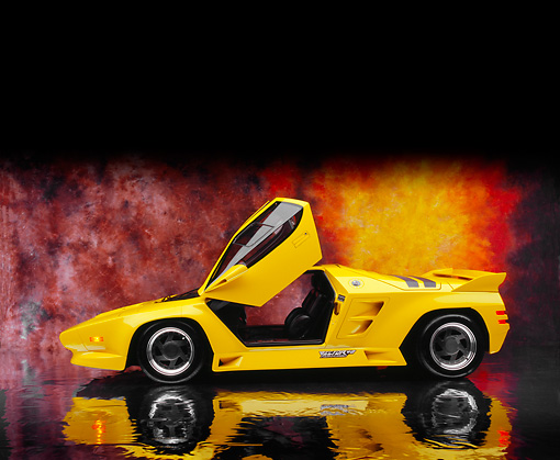 AUT 25 RK1403 04 © Kimball Stock 1992 Vector W8 Yellow Profile View Door Open On Mylar Floor Sunburst Background