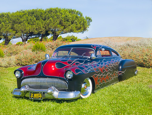 AUT 26 BK0003 01 © Kimball Stock 1951 Chevrolet Fleetline Hot Rod Black With Red Flames 3/4 Front View On Grass By Trees