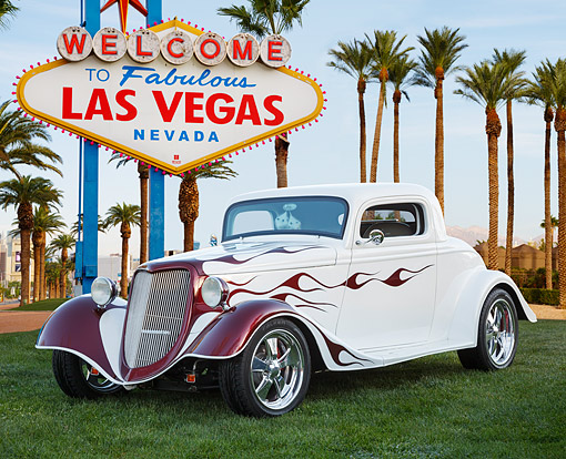AUT 26 BK0011 01 © Kimball Stock 1934 Ford White With Purple Flames 3/4 Front View On Grass By Las Vegas Sign