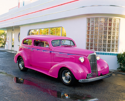 AUT 26 RK0240 02 © Kimball Stock 1937 Chevy 350/350 Nova Panther Pink 3/4 Front View On Pavement By Diner