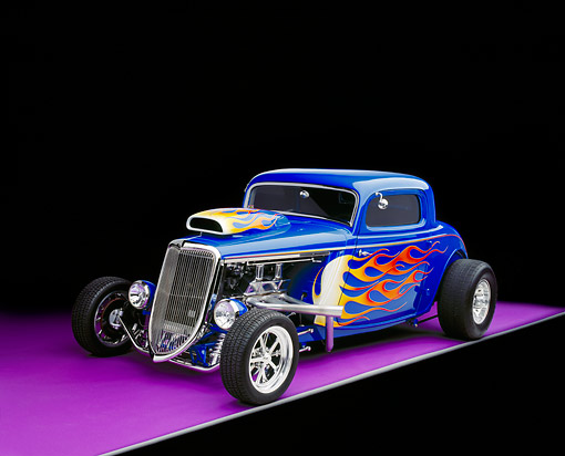 AUT 26 RK0336 08 © Kimball Stock 1934 Ford 3 Window Coupe Blue With Flames 3/4 Front View On Purple Floor Gray Line Studio