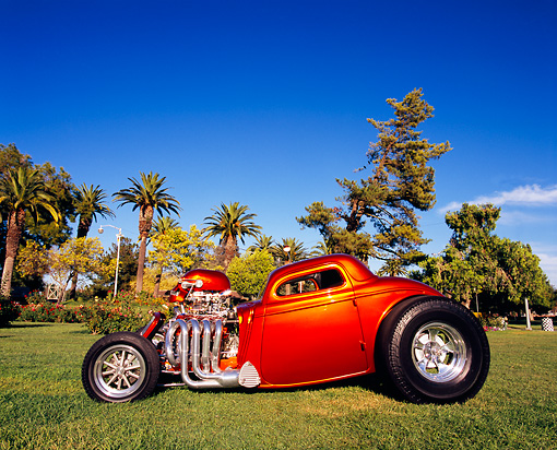 AUT 26 RK0458 08 © Kimball Stock 1933 Ford 3-Window Coupe Orange Profile View On Grass By Trees