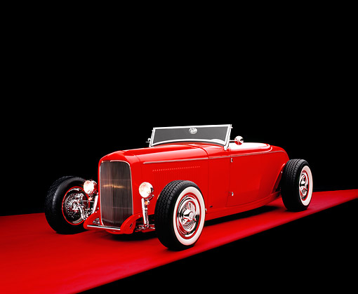 AUT 26 RK0563 02 © Kimball Stock 1932 Ford Channel Roadster Red 3/4 Front View On Red Floor Studio