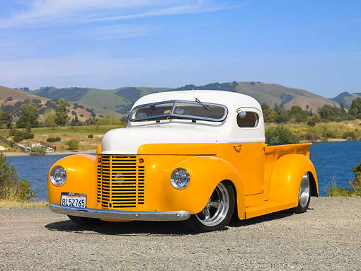 AUT 26 RK2777 01 © Kimball Stock 1947 International Pickup Truck Hot Rod Orange And White 3/4 Front View On Gravel By Lake And Hills