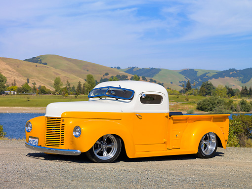 AUT 26 RK2778 01 © Kimball Stock 1947 International Pickup Truck Hot Rod Orange And White 3/4 Front View On Gravel By Lake And Hills
