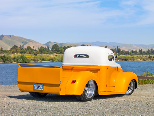 AUT 26 RK2780 01 © Kimball Stock 1947 International Pickup Truck Hot Rod Orange And White 3/4 Rear View On Gravel By Lake And Hills