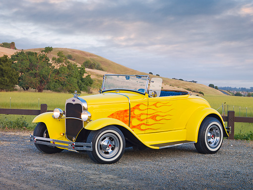 AUT 26 RK2786 01 © Kimball Stock 1931 Ford Roadster Hot Rod Yellow With Flames 3/4 Front View On Gravel By Hills