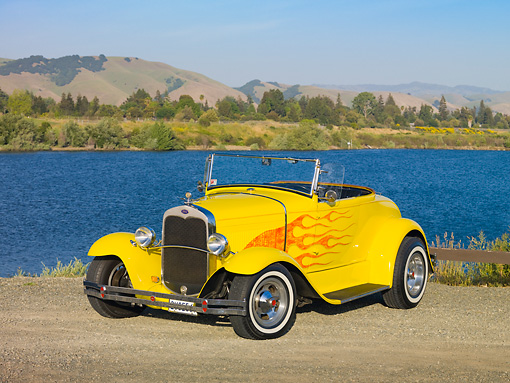 AUT 26 RK2788 01 © Kimball Stock 1931 Ford Roadster Hot Rod Yellow With Flames 3/4 Front View On Gravel By Lake