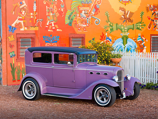 AUT 26 RK2797 01 © Kimball Stock 1931 Ford 2-Door Sedan Purple 3/4 Front View By Colorful Building
