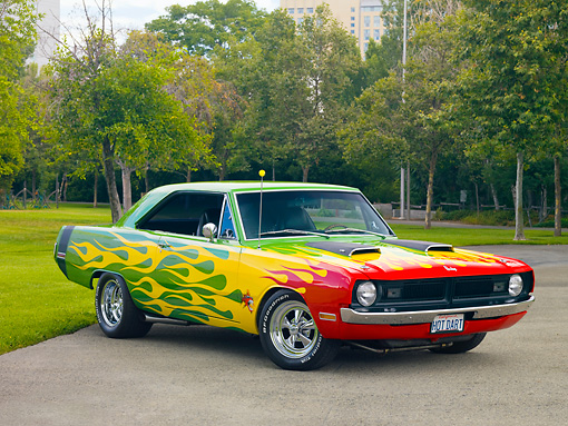 AUT 26 RK2803 01 © Kimball Stock 1970 Dodge Dart Swinger Hot Rod Red, Yellow, Green 3/4 Front View On Pavement By Trees