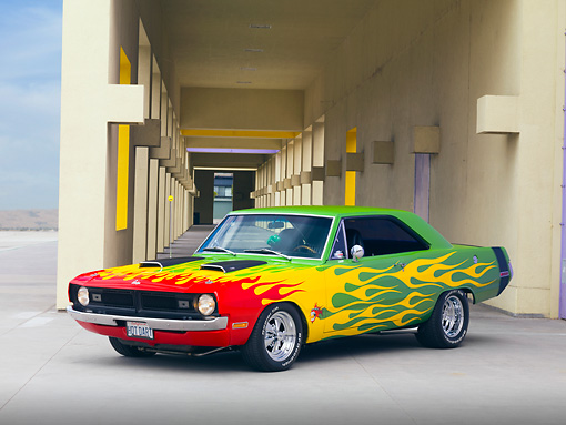 AUT 26 RK2804 01 © Kimball Stock 1970 Dodge Dart Swinger Hot Rod Red, Yellow, Green 3/4 Front View On Pavement By Building