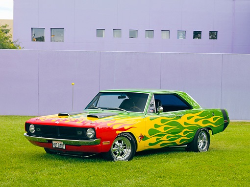 AUT 26 RK2806 01 © Kimball Stock 1970 Dodge Dart Swinger Hot Rod Red, Yellow, Green 3/4 Front View On Grass By Building