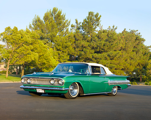 AUT 26 RK2814 01 © Kimball Stock 1960 Chevrolet Impala Convertible Hot Rod Green 3/4 Front View On Pavement By Trees