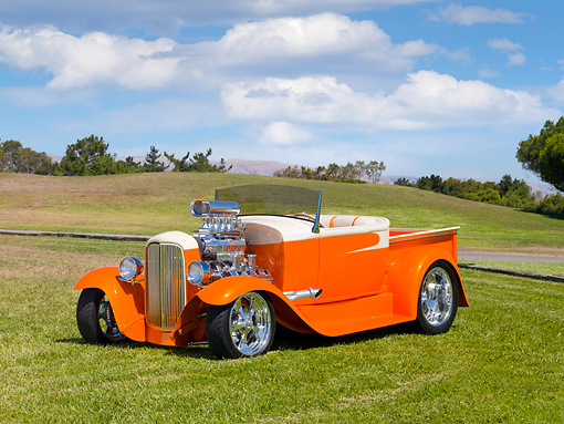 AUT 26 RK2830 01 © Kimball Stock 1931 Ford Model A Roadster Pickup Truck Hot Rod Orange And Cream 3/4 Front View On Grass