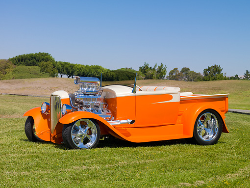 AUT 26 RK2831 01 © Kimball Stock 1931 Ford Model A Roadster Pickup Truck Hot Rod Orange And Cream 3/4 Front View On Grass