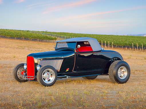 AUT 26 RK2842 01 © Kimball Stock 1929 Ford Roadster Hot Rod Black 3/4 Front View On Dry Grass