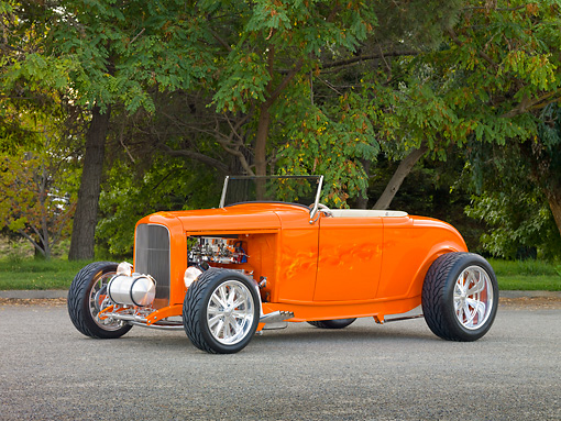 AUT 26 RK2861 01 © Kimball Stock 1932 Ford Hi-Boy Roadster Hot Rod Orange 3/4 Front View On Pavement By Trees
