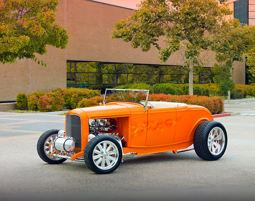 AUT 26 RK2862 01 © Kimball Stock 1932 Ford Hi-Boy Roadster Hot Rod Orange 3/4 Front View On Pavement By Building