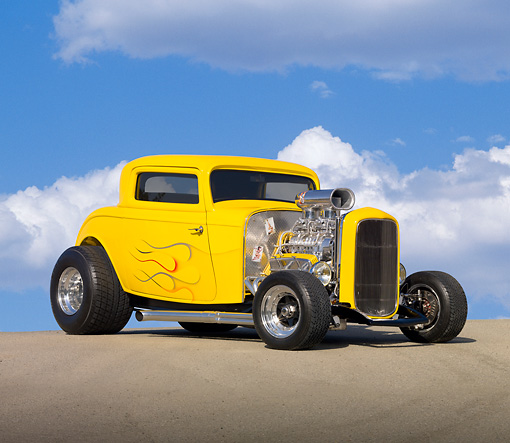 AUT 26 RK2892 01 © Kimball Stock 1932 Ford 3 Window Coupe Hot Rod Yellow With Flames 3/4 Front View On Pavement