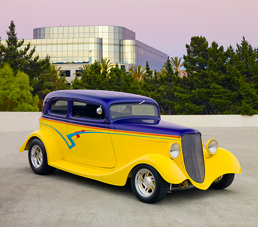 AUT 26 RK2894 01 © Kimball Stock 1933 Ford Vicky Hot Rod Yellow And Purple 3/4 Front View On Pavement