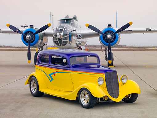 AUT 26 RK2896 01 © Kimball Stock 1933 Ford Vicky Hot Rod Yellow And Purple 3/4 Front View On Pavement By Airplane