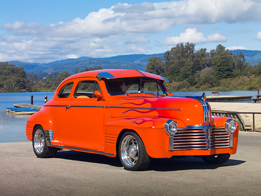 AUT 26 RK2898 01 © Kimball Stock 1941 Pontiac Special Coupe Hot Rod Orange With Flames 3/4 Front View On Pavement By Lake