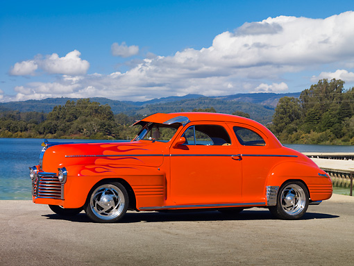 AUT 26 RK2899 01 © Kimball Stock 1941 Pontiac Special Coupe Hot Rod Orange With Flames 3/4 Front View On Pavement By Lake