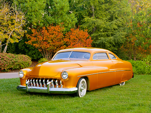 AUT 26 RK2901 01 © Kimball Stock 1951 Mercury Coupe Hot Rod Gold 3/4 Front View On Grass By Trees