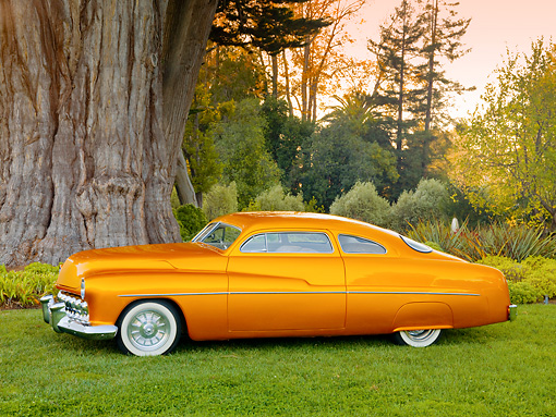 AUT 26 RK2904 01 © Kimball Stock 1951 Mercury Coupe Hot Rod Gold Profile View On Grass By Trees