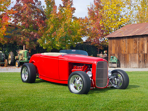 AUT 26 RK2910 01 © Kimball Stock 1932 Ford Roadster Hot Rod Red 3/4 Front View On Grass By Barn