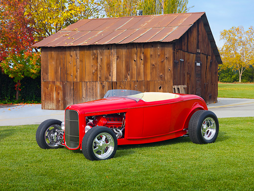 AUT 26 RK2912 01 © Kimball Stock 1932 Ford Roadster Hot Rod Red 3/4 Front View On Grass By Barn