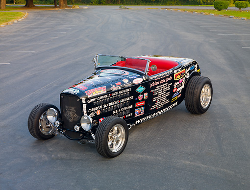 AUT 26 RK2928 01 © Kimball Stock 1932 Ford Roadster Hot Rod Black With Decals 3/4 Front View On Pavement