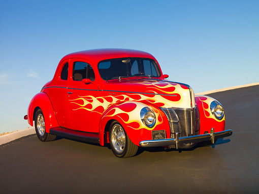 AUT 26 RK2930 01 © Kimball Stock 1940 Ford Deluxe Coupe Hot Rod Red With Flames 3/4 Front View On Pavement