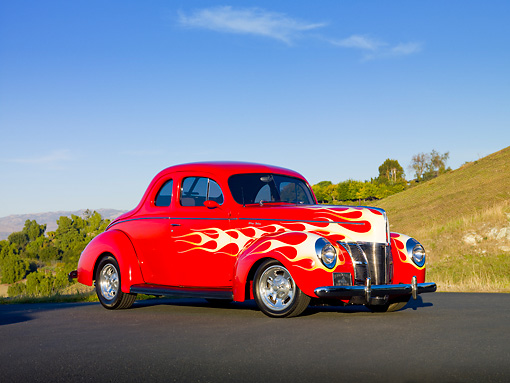 AUT 26 RK2933 01 © Kimball Stock 1940 Ford Deluxe Coupe Hot Rod Red With Flames 3/4 Front View On Pavement