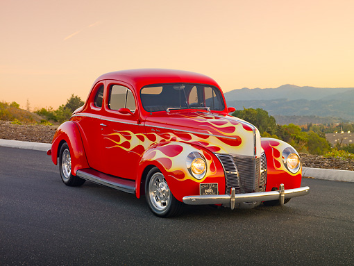 AUT 26 RK2935 01 © Kimball Stock 1940 Ford Deluxe Coupe Hot Rod Red With Flames 3/4 Front View On Pavement