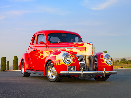AUT 26 RK2936 01 © Kimball Stock 1940 Ford Deluxe Coupe Hot Rod Red With Flames 3/4 Front View On Pavement