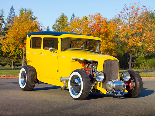 AUT 26 RK2939 01 © Kimball Stock 1931 Ford Sedan Hot Rod Yellow 3/4 Front View On Pavement By Trees