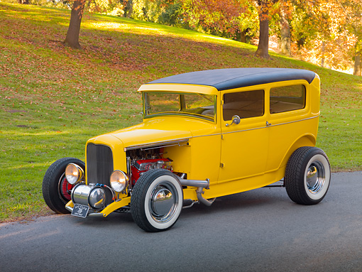 AUT 26 RK2942 01 © Kimball Stock 1931 Ford Sedan Hot Rod Yellow 3/4 Front View On Pavement By Hill